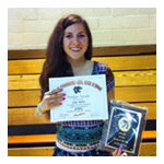 "Saige posing with her ""Rookie of the Year"" award for 10th grade varsity softball."